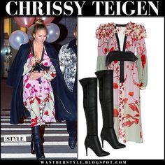 Chrissy Teigen in floral print midi dress and black boots