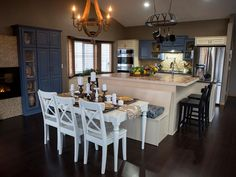 This open-floor plan has everything to cook and entertain a crowd. The homeowners wanted to make the kitchen family friendly but with a touch of formality and elegance.