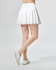 Serve your best look in this tennis classic with built in shorts and MICHI logo elastic waistband. Designed for high performance, the perforated mesh panels and lightweight fabric allows for ease of movement and a figure-flattering Hot Pants, White Skirts, S Models, Bra Tops, Workout Wear, Fashion 2020, Tennis, Casual Outfits, Mesh