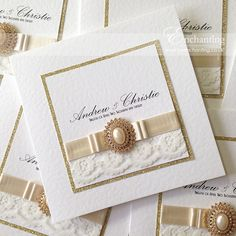 Bespoke Design - Classic Fold Invitation | Featuring peal ivory satin ribbon, ivory lace, dior bow, gold glitter mount and gold crystal diamante and pearl oval embellishment | Luxury handmade wedding invitations and stationery #byenchanting
