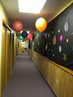 """My VBS Blast Off 2014 hallway to the """"space museum."""" (Inspired by other pinners on Pinterest!) I used punch balloons which were larger, rounder, and sturdier to create my Solar System! Hung with fishing line."""
