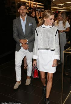 Happy couple: Olivia was accompanied by her model husband, Johannes Huebl, at the launch o...