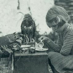"""Tea party for a lobster and a hawk, August 1938. """"Anne and her family lived alone on an island. She enjoyed having tea time with her friends the spiny lobster and baby hawk."""" National Geographic, August 1938 [With thanx to Rian K.]"""