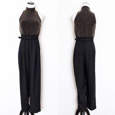 """Black & Gold Glitter High Neck Belted Jumpsuit John Roberts ⑊ Size 10P  ⌁ Measurements: 17"""" bust 32"""" waist 14"""" rise 28"""" inseam 55"""" overall length  ⌁ Material: 77% nylon 17% polyester 6% spandex  ⌁ Condition: Vintage & used. Top part has some light snags. Otherwise, in great condition.   Comment below if you have other questions. Please make all offers using the """"offer"""" button. No trades or PayPal. No holds (first come, first serve). Comes from a smoke-free/pet-free home. Not responsible for…"""