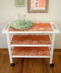 upcycling, furniture. Using wall paper to cover shelves of the cart instead of painting them.