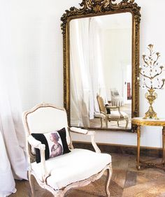 Oh. My. GYAH.  Oversized mirror + tattered French chair + gilded stuff + beat up hardwoods.