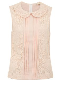 Lace Panel Blouse. This sleeveless blouse has a rounded collar and lace applique panels on the front.