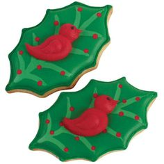 Season's Tweetings Cookie - Flying in for the festivities—a flock of holiday doves are figure piped on holly-shaped cookies. Everyone loves the leaf details—vein lines and berries—which are piped in thinned Color Flow icing.