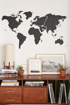 This black minimal world map wall decal is the perfect addition to the wall above a shelf or table dedicated to your worldly travels.
