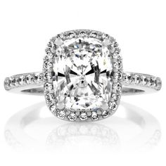 3.00 carat elongated cushion cut set in a platinum halo setting held by eagle prongs. BOOM.Pavé