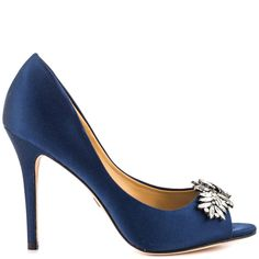 Beauty can be wrapped up in the ritzy Buzz pump by Badgley Mischka. Supple navy satin drapes over the entire look while a stunning brooch details the peep toe vamp. Leaving you with a flawless strut is a perfect 4 inch stiletto heel.