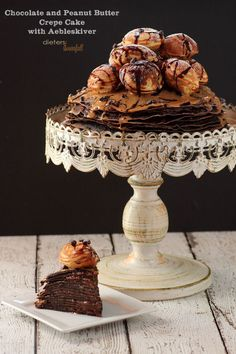 This has to be one of the most beautiful cakes I have ever seen!  Eighteen Chocolate Crepes filled with Chocolate and Peanut Butter and then topped with more! Add on a few Aebleskiver and call it perfect! f...