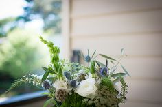Bridal Bouquet: scabiosa pods, thistle, star-of-bethlehem (ornithogalum), queen anne's lace, olive branches, bells of ireland, dianthus