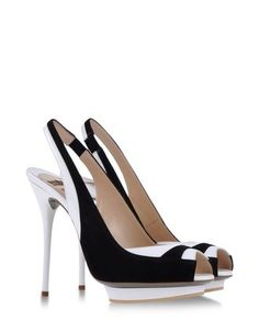 A great pair of black and white color block heels are a must-have for this season...and these by Ernesto Esposito are stunning!