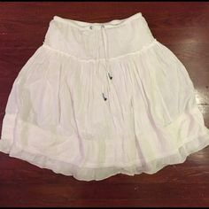 Precious White AE Skirt Super adorable white and eyelet skirt from American Eagle. Great little blue daisy detailing around the drawstring waist. Perfect condition. American Eagle Outfitters Skirts