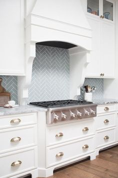 Blue herringbone cooktop tiles