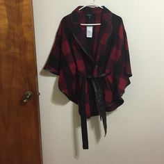 Plaid red & black poncho jacket Plaid & red poncho jacket with faux leather belt that raps around the waist. Never been worn with tags still attached. Rue 21 Jackets & Coats