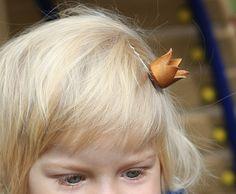 Teeny, tiny crown on a bobby pin.