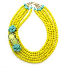"""five strands of faceted yellow crystal, a cheerful backdrop for a quartet of vintage earrings, turquoise baubles that bring their own fun to the mix. Fastened by a hammered bronze hook from Thailand, this happy design measures 17.5"""" in length. $ 228.00"""