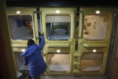 Largest capsule hotel in Qingdao, Shandong province, January 15, 2013. The hotel has 100 capsule rooms, each equipped with an LCD TV, WiFi connection, a computer desk, a dresser and comfortable bedding.