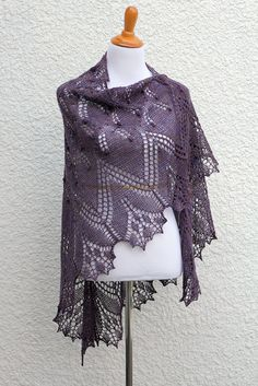 Knit shawl with nupps in red violet color, gift for her. Knit shawl, lace shawl made of 100% wool yarn in lovely red violet color. Perfect gift for her, gift for mom! It's perfect with an elegant dress and also with jeans or shirt and there is a lot of ways to wear it. This hand knit shawl is very light and delicate. Measures: spreads: 72 inches height: 40 inches Hand wash and dry flat. Block it if you can. Shown color: Clematis This yarn is heather which means there are few different…