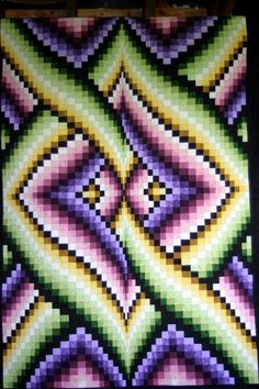 Thinking of a Bargello quilt in dark colors for Evan.