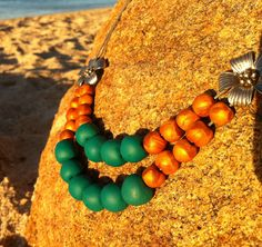 Jade and gold polymer clay and metal beaded leather necklace.