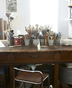 Tins and mugs for paint brushes.  I use jars, but I love the look of this for art storage