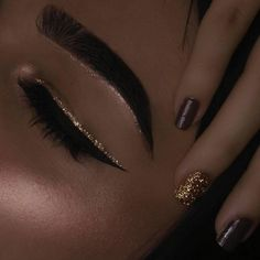 Eyeshadow Inspiration: Cat Eyeliner with Gold above and Gold under brow bone.
