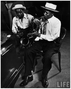 Saxophonist Illinois Jacquet & trumpeter Harry Edison at recording session for film %22Jammin' the Blues,%22 being directed by photographer ...