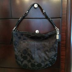 Coach, authentic, black hobo style handbag Coach, authentic, previously loved, black hobo style handbag. In excellent condition, only used a few times. Exterior has silver hardware, zipper closure, and a convenient outside pocket for keys, phone, etc.  Interior has one zipper pocket and two interior open pockets. Includes a dust cover. Coach Bags Hobos
