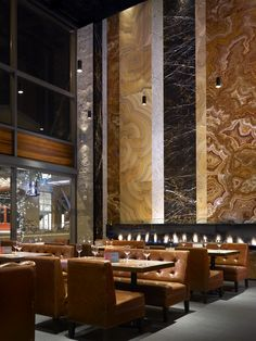 Fireplace Wall - Earls Restaurant creates a feature wall designed by layering different types/colours of metamorphic rock in various sizes around the linear fireplace. Deco Restaurant, Restaurant Lounge, Bar Lounge, Restaurant Design, Restaurant Lighting, Restaurant Ideas, Wood Fireplace, Fireplace Design, Fireplaces