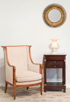 A cozy spot with gorgeous pieces. #Vintage sunburst and alabaster lamp, #antique armchair (beautiful carving and inlays!) and a French Empire period side table.