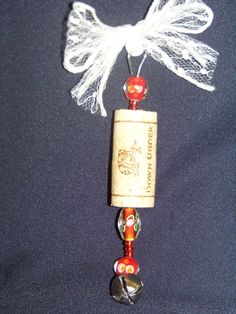 Wine cork beaded ornaments make fabulous hostess gifts!  All you need is a used wine cork (easier if it was pulled from the bottle with a cork screw leaving a hole down the center), large paper clip, beads, ribbon of your choice, and small-nosed pliers.