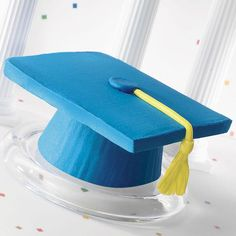 Goody for the Grad! Cupcakes - Topping off success has never been easier and more impressive! Just invert standard muffins, ice and top with 3 1/2 in. square cookies to create a mortarboard. The tassel is cleverly made with yellow taffy. Hats off to this most- likely-to-succeed dessert.