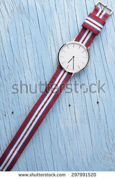 Wristwatch on old wooden table