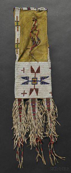- LAKOTA BEADED HIDE PIPEBAG, C. LAST QUARTER 19TH CENTURY, WITH YELLOW-STAINED HIDE, BEADED WITH MULTICOLOR GEOMETRIC AND CROSS DESIG... - Skinner Inc