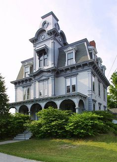 Second Empire - at first glance, you might mistake a Second Empire house for an Italianate. Both have a somewhat boxy shape. But a Second Empire house will always have a high mansard roof. Inspired by the architecture in Paris during the reign of Napoleon Victorian Architecture, Beautiful Architecture, Beautiful Buildings, Beautiful Homes, French Architecture, Style At Home, Victorian Style Homes, Victorian Houses, Victorian Gothic