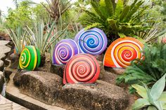landscape with colorful snail sculptures