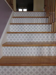 Stenciled stair risers. I don't think I would use so many different ones maybe just one or two  patterns on every other step.