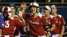 With a wicked swing that runs in the family, Sydney Romero hit her fourth home run of the NCAA tournament to give Oklahoma a 3-2 win over Auburn in Game 1 of the Women's College World Series.