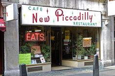 New Piccadilly Cafe. A fantastic, original 50s Italian cafe, complete with Formica tables and waiters in white starched jackets featuring epaulettes. Closed just before the building was demolished in September 2007.