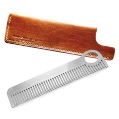 Model No. 1 + Tan Sheath Set - Matte Finish by CHICAGO COMB -The iconic 5.5'' long, medium tooth comb. Laser-cut stainless steel, hand-finished for comfortable daily use. The Matte has a special brushed metal, satin finish. Custom leather sheath specially designed for Model 1 and Model 3 combs. English tan color. Hand-crafted in Chicago by Ashland Leather, using top quality leather from Chicago's world-famous Horween tannery.