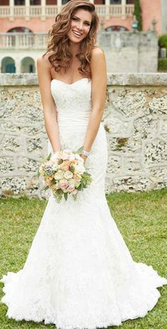 wedding dress. Love the dress, just subtle and not too much. And bouquet is pretty
