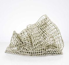 The material, ceramic, contradicts the form of the subject.  These sculptures by Annie Turner are inspired by the waterways of the Deben in Suffolk, although I didn't realise that when I first saw 'Net' in the Fitzwilliam at Cambridge.