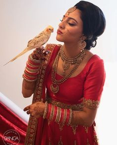 WEBSTA @ indianweddingbuzz - Love this shot of the bride and her feathery friend!