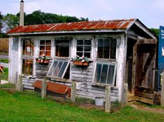 Awesome Coop-white washed wood ~ window boxes ~tin roof ~ barn door ~awning windows