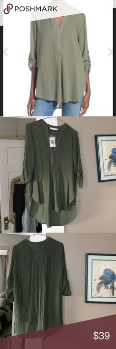 Hunter green tunic Great lightweight tunic for every season! High low hem, 3/4 sleeves with button loop detail. Throw this over any pair of jeans or tuck the front into any kind of bottom. Closet staple, timeless. Runs a little oversized, can fit up to a small. Brand new with tags. Brand is Lush. Bundle to save! Anthropologie Tops Tunics