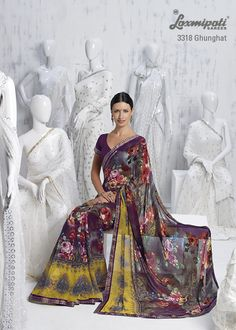 This multi color floral saree is appealing the great fashion in town.