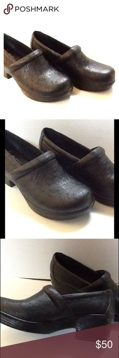 B.O.C. Black Clogs Brand new in original box. Style name is Nadiyya. All synthetic materials. Black stamped design. Platform approx .75 heel is approx 2.25. b.o.c. Shoes Mules & Clogs